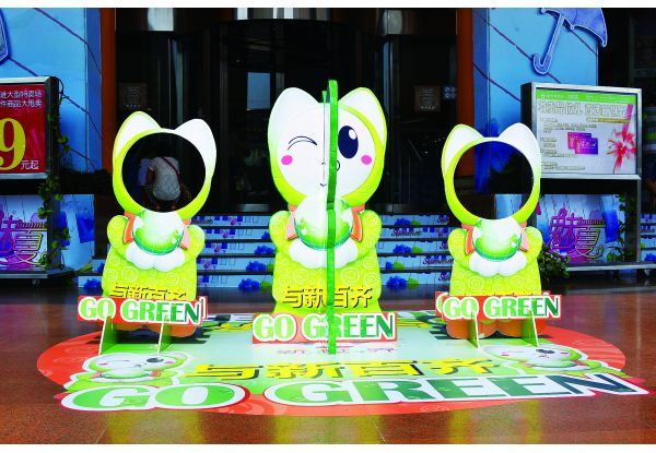 """In line with the theme, every store's customer service and cashier counters were decorated with marketing materials developed by the event mascot """"GAGA Green Fighter""""."""