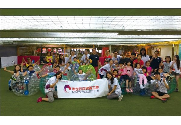 """Hong Kong office took under-resourced children from The Hong Kong Federation of Youth Groups to play the most in-trend """"bubble soccer""""."""